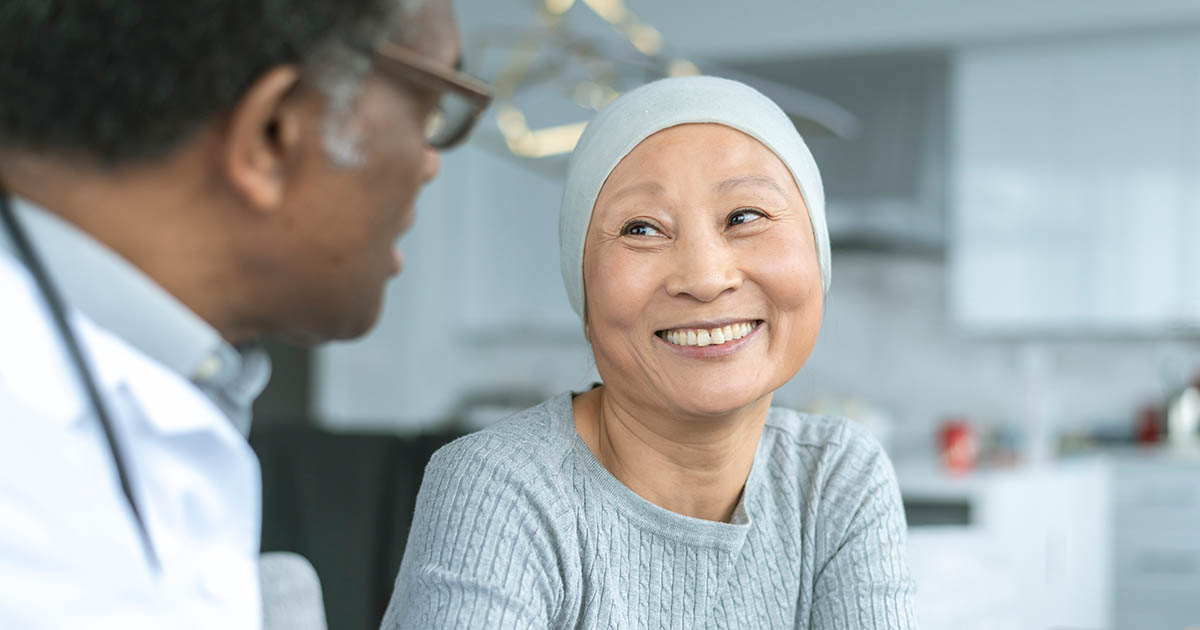 A woman with cancer is meeting with her doctor.