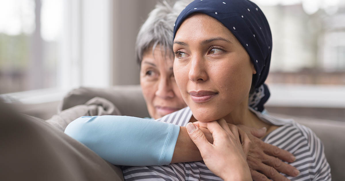 Cancer patient is being hugged by a family member