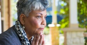 Mature woman looking concerned