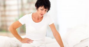 Woman is experiencing pain on the right side of her abdomen