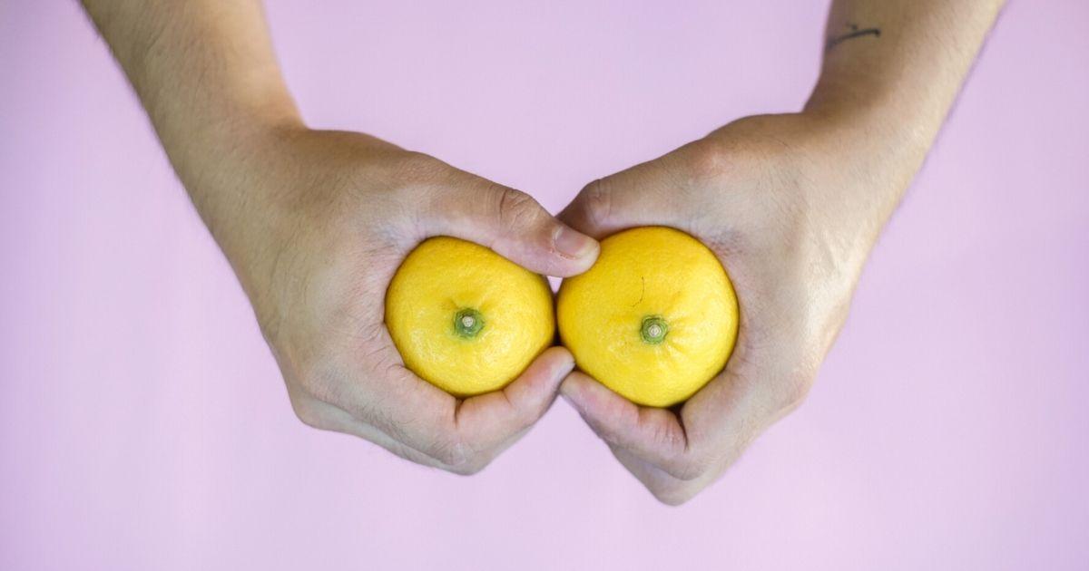 Someone holding lemons.