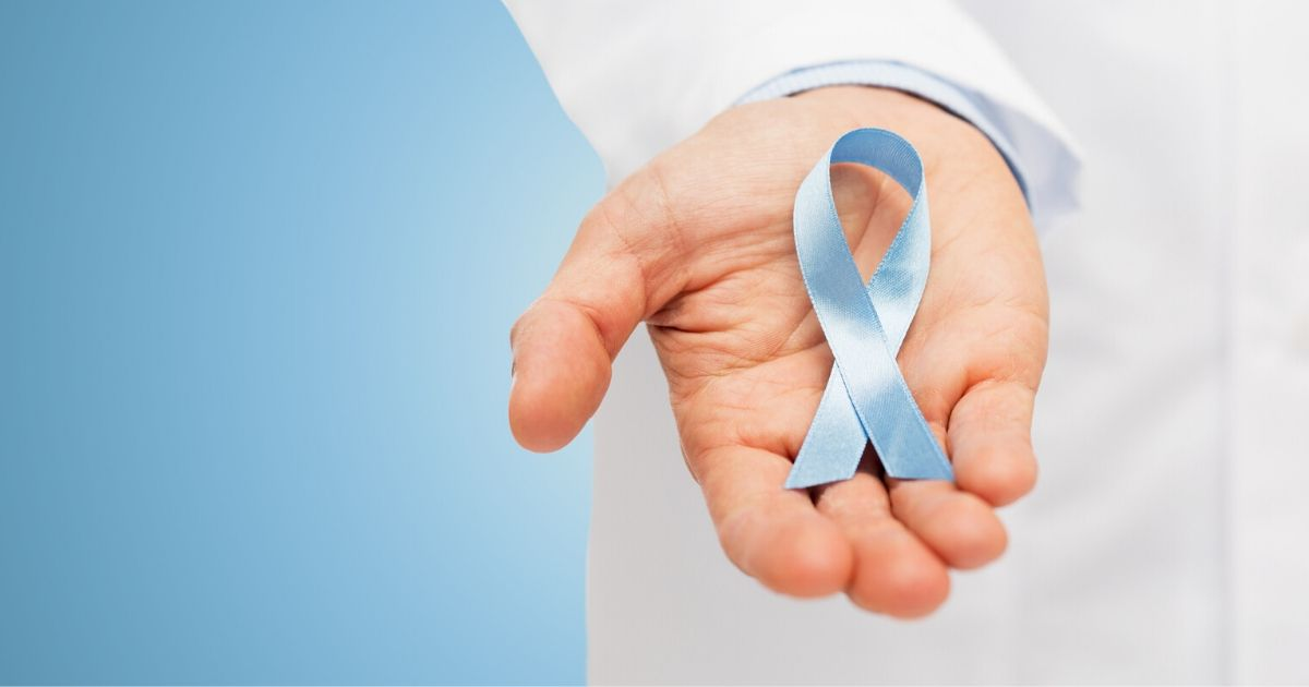 a doctor holding a prostate cancer treatment ribbon