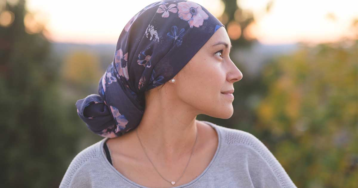 a woman with cancer looking hopeful