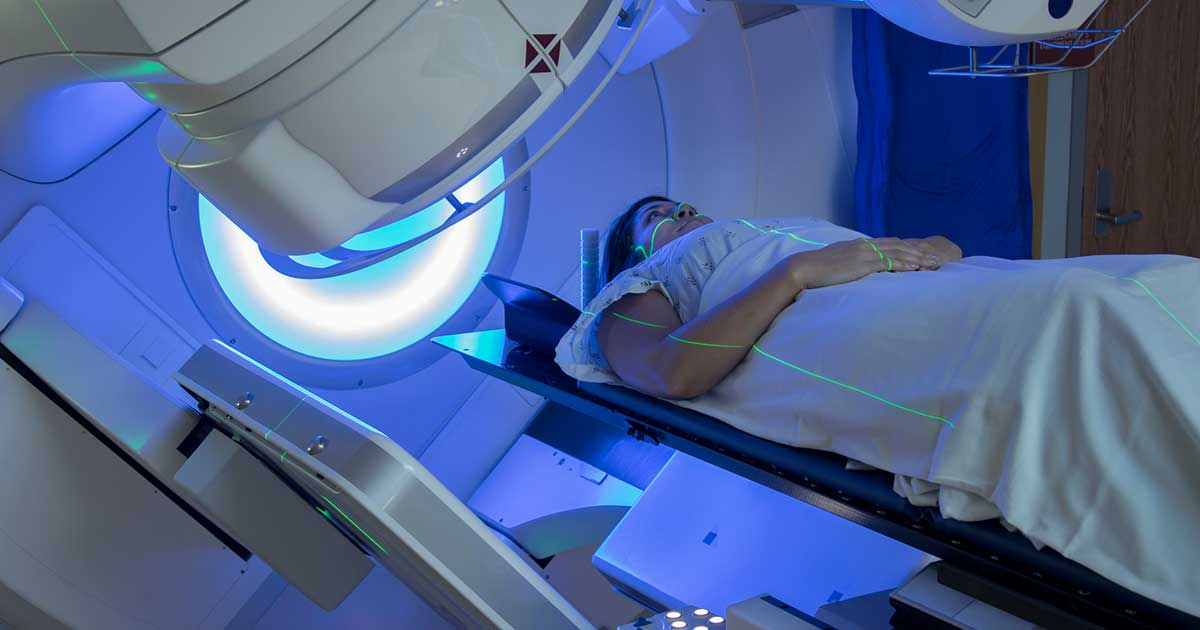 a woman receiving radiation therapy for cancer treatment