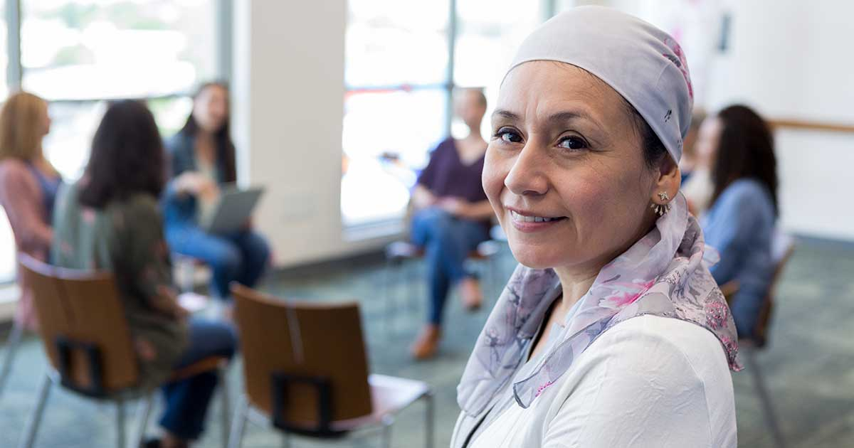 a cancer patient at a cancer support community meeting