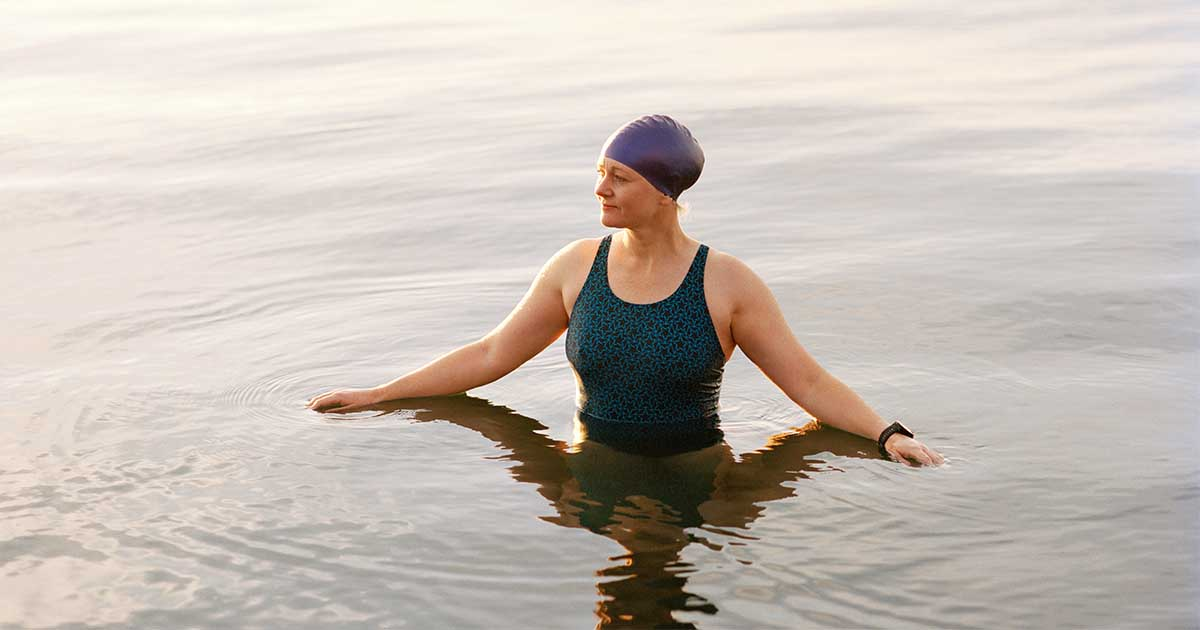 A woman swimming in a lake.
